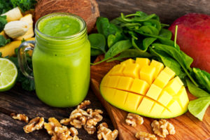 Healthy Green Reach Vitamins Smoothie with baby leaf spinach, kale, mango, banana, lime, walnut and coconut water